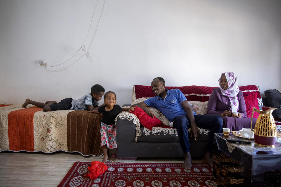 Musa Family, Sudanese migrant sits in their living room at their house in south Tel Aviv, Israel, Friday, Oct. 30, 2020. After Israel and Sudan agreed this month to normalize ties, some 6,000 Sudanese migrants in Israel are again fearing for their fate. Israel has long grappled with how to deal with its tens of thousands of African migrants. (AP Photo/Oded Balilty)