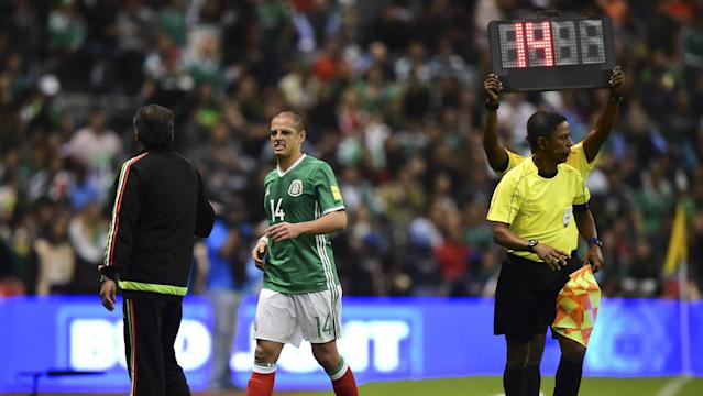 After tying Mexico's all-time goal scoring record Friday, the forward may miss the team's trip to the Caribbean for Tuesday's qualifier.