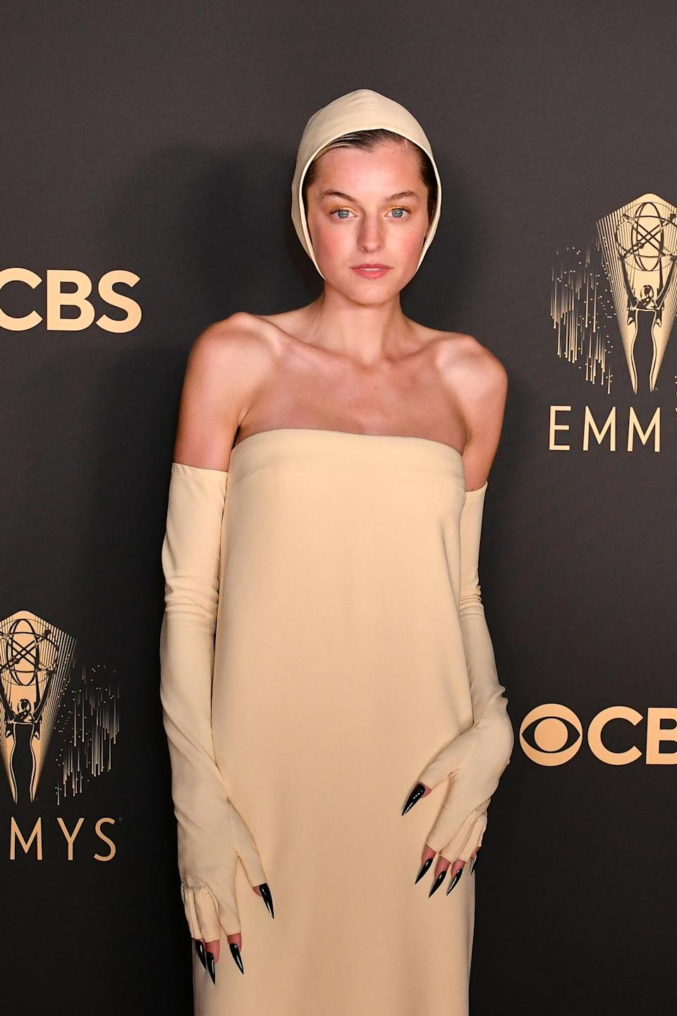 """<p>Emma Corrin's face <em>and </em>nails are standing out on tonight's red carpet. <em>The Crown</em> actress worked with makeup artist <a href=""""https://www.instagram.com/florriewhitemakeup/"""" rel=""""nofollow noopener"""" target=""""_blank"""" data-ylk=""""slk:Florrin White"""" class=""""link rapid-noclick-resp"""">Florrin White</a> who used BYREDO products to create her warm, glowy makeup look, along with nail tech <a href=""""https://www.instagram.com/simmy_nailsandbeauty/"""" rel=""""nofollow noopener"""" target=""""_blank"""" data-ylk=""""slk:Simone Cummings"""" class=""""link rapid-noclick-resp"""">Simone Cummings</a> who molded her show-stopping glossy black claws. </p>"""