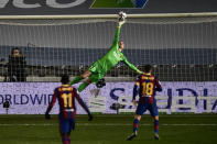 Barcelona's goalkeeper Marc-Andre ter Stegen makes a save during Spanish Super Cup semi final soccer match between Barcelona and Real Sociedad at Nuevo Arcangel stadium in Cordoba, Spain, Wednesday, Jan. 13, 2021. (AP Photo/Jose Breton)