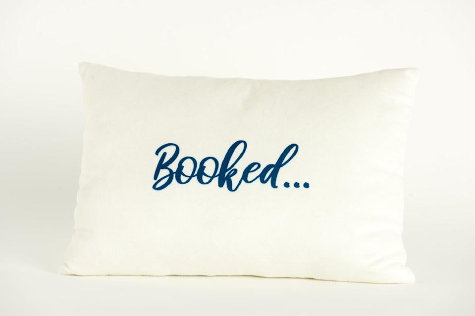 """<p>Book-lovers will love to use this <span>Disney Princess X POPSUGAR Belle Booked For the Weekend Decor Pillow</span> ($20) in their favorite reading nook. It reads """"Booked"""" on one side and """"for the weekend"""" on the other.</p>"""