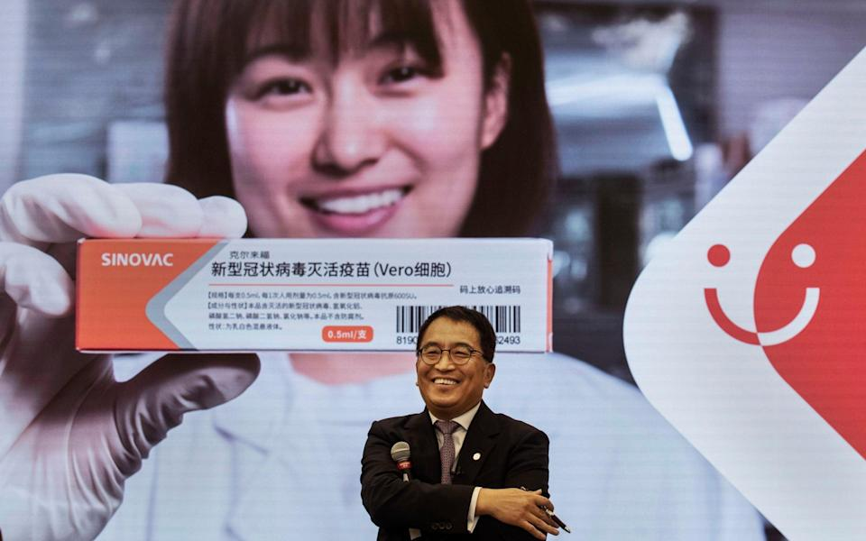 SinoVac Biotech CEO Yin Weidong speaks to journalists at the production site of their potential Covid-19 vaccine - Kevin Frayer /Getty Images AsiaPac