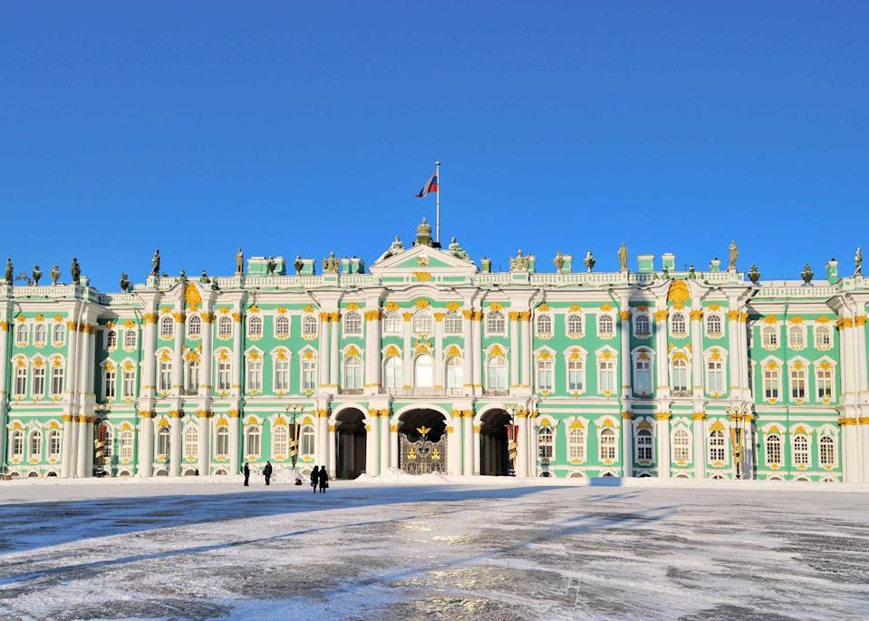 """Few travel images are superimposed on our imaginations the way St. Petersburg in the winter is. The colorful and whimsical towers of the Church of the Savior on Blood look especially striking against crisp, fresh-fallen snow. But like most of <a href=""""https://www.cntraveler.com/story/exploring-kamchatka-russias-adventure-playground?mbid=synd_yahoo_rss"""" rel=""""nofollow noopener"""" target=""""_blank"""" data-ylk=""""slk:Russia"""" class=""""link rapid-noclick-resp"""">Russia</a>, winter in the city is frigidly cold; rivers and canals freeze, the days are short, and temperatures average between –4 degrees and –28 degrees Fahrenheit between January and February. Embrace the cold and celebrate: Orthodox Christmas, Russian New Year, and a sporting event called the Big Neva Cup, which involves a swimming pool carved into ice, are a few occasions on which to do so."""