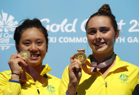 Diving - Gold Coast 2018 Commonwealth Games - Women's Synchronised 3m Springboard - Victory Ceremony - Optus Aquatic Centre - Gold Coast, Australia - April 11, 2018. Esther Qin and Georgia Sheehan of Australia pose with their gold medals. REUTERS/David Gray