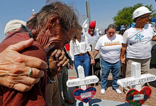 PHOTO: Antonio Basbo cries while standing next to the cross for his partner Margie Reckard at the make shift memorial for the mass shooting at a Walmart in El Paso, Texas, Aug. 5, 2019. (Larry W. Smith/EPA via Shutterstock)