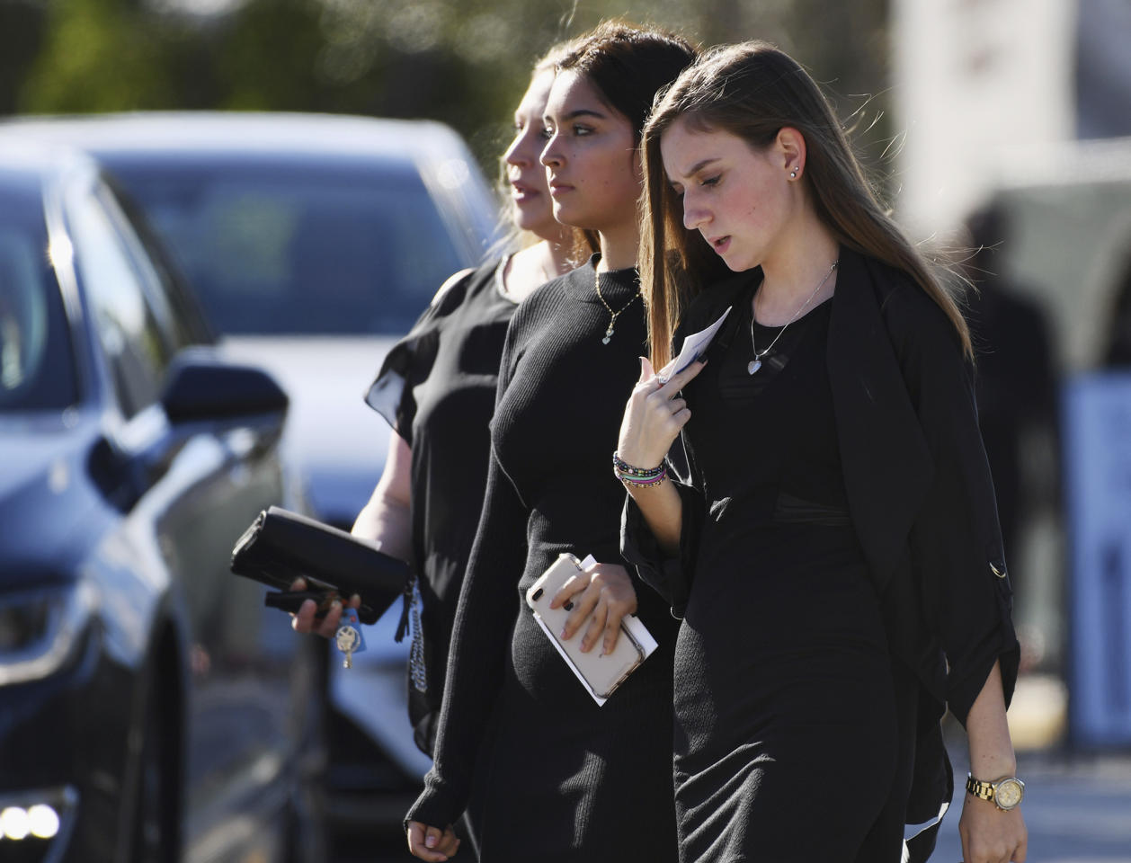 Mourners leave the funeral service at Temple Beth El in Boca Raton, Fla., for Scott Beigel, a teacher at Marjory Stoneman Douglas High School who was killed in Wednesday's mass shooting, on Sunday, Feb. 18, 2018. (Jim Rassol/South Florida Sun-Sentinel via AP)