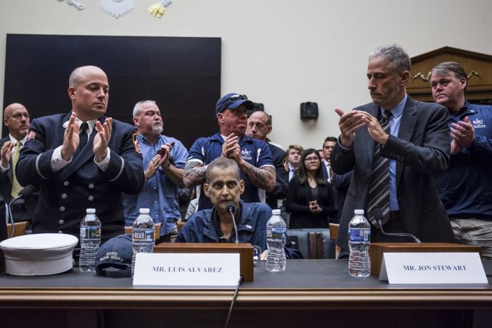 Jon Stewart, right, applauds following testimony from retired NYPD detective and 9/11 first responder Luis Alvarez during a House Judiciary Committee hearing last week on Capitol Hill. (Photo: Zach Gibson/Getty Images)