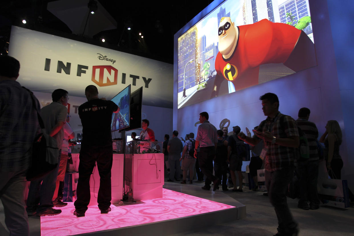 People visit the Disney Infinity exhibit at E3, the Electronic Entertainment Expo, in Los Angeles, California, June 11, 2013.    REUTERS/David McNew (UNITED STATES - Tags: SCIENCE TECHNOLOGY SOCIETY BUSINESS)