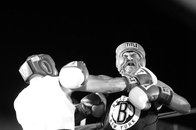 <p>Anthony Mangano lands a right to the chin of Rich Altamirano during a grudge match at the Brooklyn Smoker in the parking lot of Gargiulo's Italian restaurant in Coney Island, Brooklyn, on Aug. 24, 2017. Mangano won the bout unanimously. (Photo: Gordon Donovan/Yahoo News) </p>