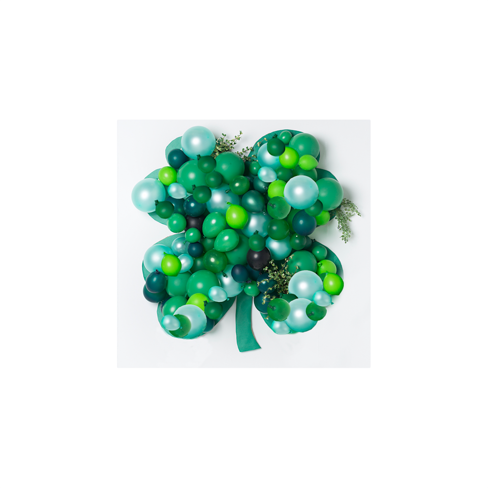 """<p>To really wow your guests, DIY a giant shamrock balloon. It's the perfect backdrop for a dessert table or photo booth.  </p><p><a class=""""body-btn-link"""" href=""""https://thehousethatlarsbuilt.com/2015/03/balloon-shamrock-backdrop.html/"""" target=""""_blank"""">GET THE TUTORIAL</a></p><p><a class=""""body-btn-link"""" href=""""https://www.amazon.com/AnnoDeel-Balloons-Birthday-Wedding-Decorations/dp/B079ZN4P62/ref=sxin_3_ac_d_rm?ac_md=0-0-Z3JlZW4gYmFsbG9vbnM%3D-ac_d_rm&cv_ct_cx=green+balloons&keywords=green+balloons&pd_rd_i=B079ZN4P62&pd_rd_r=8fda2b8f-e9c7-4208-a1f1-2c82938b580c&pd_rd_w=VBPw4&pd_rd_wg=nocBD&pf_rd_p=de19e82a-2d83-4ae8-9f5c-212586b8b9a0&pf_rd_r=V9AV7Y2S00S7QN4MD9AJ&psc=1&qid=1581384049&sr=1-1-12d4272d-8adb-4121-8624-135149aa9081&tag=syn-yahoo-20&ascsubtag=%5Bartid%7C10072.g.30833564%5Bsrc%7Cyahoo-us"""" target=""""_blank"""">SHOP BALLOONS</a></p>"""