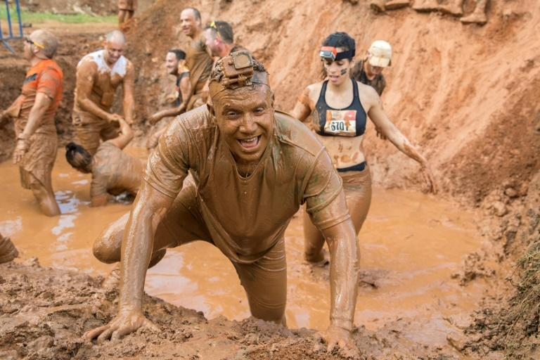 Contestants take part in the Mud Day race, a 13- kilometre (eight-mile) obstacle course, on March 24, 2017 in the Israeli city of Tel Aviv