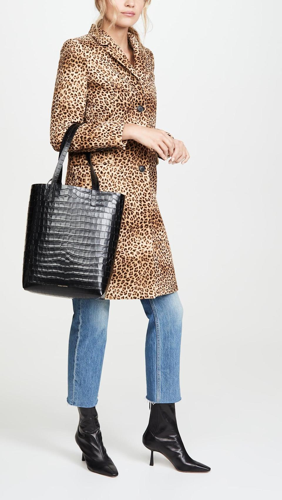 """<p>I've been dreaming of a new bag that I can take to work every day and that fits my laptop. This <a href=""""https://www.popsugar.com/buy/Mansur-Gavriel-Everyday-Tote-523295?p_name=Mansur%20Gavriel%20Everyday%20Tote&retailer=shopbop.com&pid=523295&price=695&evar1=fab%3Aus&evar9=45509008&evar98=https%3A%2F%2Fwww.popsugar.com%2Ffashion%2Fphoto-gallery%2F45509008%2Fimage%2F46947617%2FMansur-Gavriel-Everyday-Tote&list1=shopping%2Csales%2Cblack%20friday%2Csale%20shopping%2Cblack%20friday%20sales&prop13=mobile&pdata=1"""" rel=""""nofollow noopener"""" class=""""link rapid-noclick-resp"""" target=""""_blank"""" data-ylk=""""slk:Mansur Gavriel Everyday Tote"""">Mansur Gavriel Everyday Tote</a> ($695) is at the top of my wishlist. Shopbop is having up to 25 percent off full-price items, now's the perfect chance to buy.</p>"""