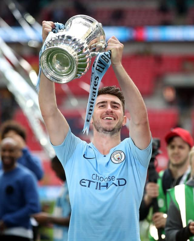 Aymeric Laporte lifts the FA Cup (Nick Potts/PA)