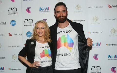 50 year old Kyle Minogue and her former fiancé, Joshua Sasse, who split two years ago - Credit:  Cole Bennetts/Getty