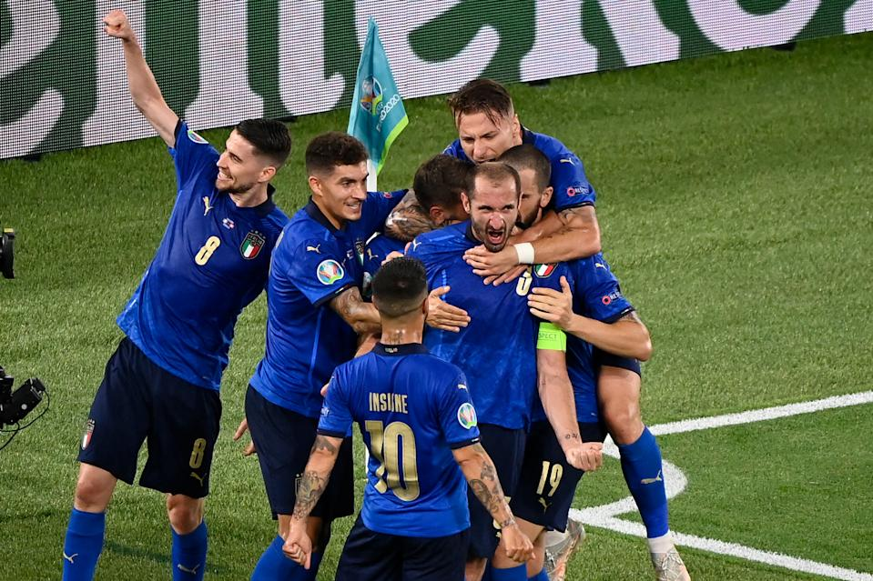Italy's defender Giorgio Chiellini (3) celebrates with teammates after scoring, before the goal was cancelled after a VAR check, during the UEFA EURO 2020 Group A football match between Italy and Switzerland at the Olympic Stadium in Rome on June 16, 2021. (Photo by Riccardo Antimiani / POOL / AFP) (Photo by RICCARDO ANTIMIANI/POOL/AFP via Getty Images)