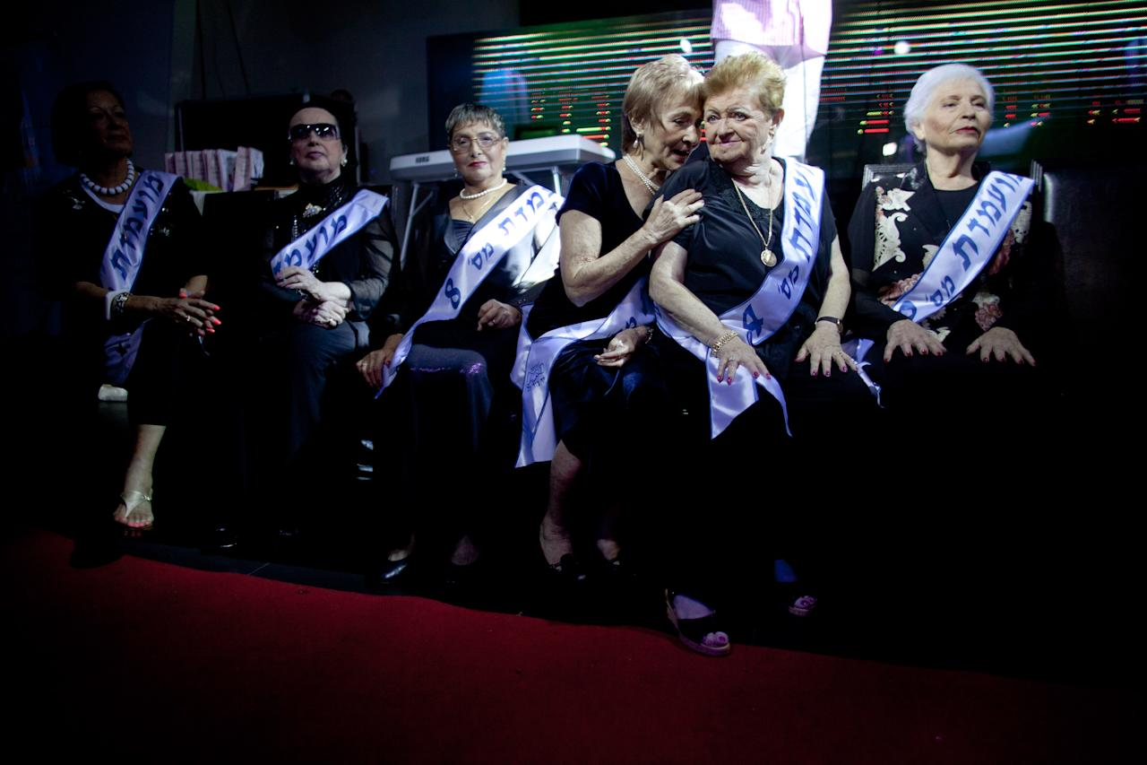Israeli Holocaust survivors and beauty pageant contestants, wait for the pageant to start on June 28, 2012 in Haifa, Israel. During the pageant, the twenty women competing, between 74 to 90 years of age, shared Holocaust stories witht he audience. (Photo by Uriel Sinai/Getty Images)