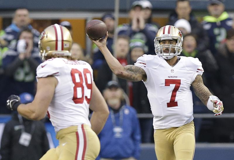 San Francisco 49ers' Colin Kaepernick throws to Vance McDonald during the first half of the NFL football NFC Championship game against the Seattle Seahawks Sunday, Jan. 19, 2014, in Seattle. (AP Photo/Elaine Thompson)