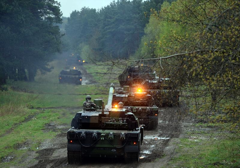 French soldiers drive tanks in Drawsko Pomorskie, northern Poland, as part of a NATO military exercise in April 2015 (AFP Photo/Janek Skarzynski)