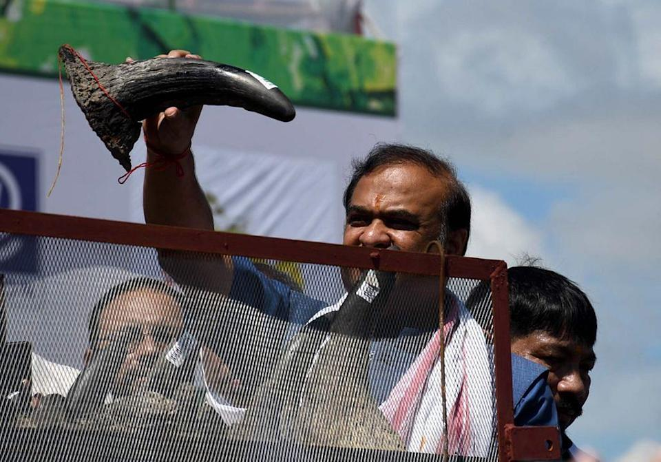 """<div class=""""paragraphs""""><p>Chief Minister of Assam Himanta Biswa Sarma inaugurates the event holding a Rhino horn </p></div>"""
