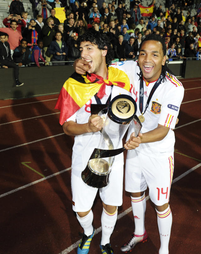 Emilio Nsue (R) and Daniel Parejo of Spain celebrates with the trophy at the end of the UEFA Under-21 European Championship final football match Spain vs Switzerland at the Aarhus Stadium, on June 25, 2011. Spain won 2-0.AFP PHOTO/JONATHAN NACKSTRAND (Photo credit should read JONATHAN NACKSTRAND/AFP/Getty Images)