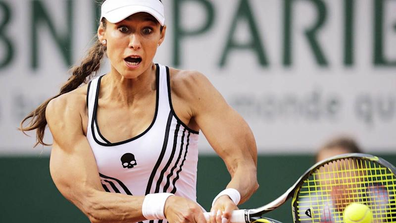 Vitalia Diatchenko and her huge biceps in action. (Photo by THOMAS SAMSON/AFP/Getty Images)