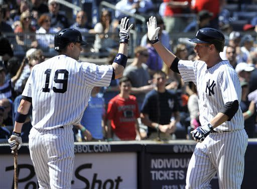 New York Yankees's Chris Stewart (19) high-fives with Lyle Overbay after Overbay hit a solo home run off of Oakland Athletics starting pitcher Bartolo Colon in the fifth inning of a baseball game at Yankee Stadium on Saturday, May 4, 2013 in New York. Stewart hit a solo home run in the third inning. (AP Photo/Kathy Kmonicek)