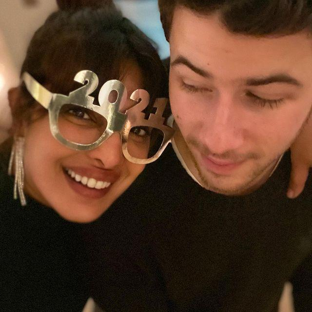 """<p>The pair celebrated New Year's Eve in London, wearing matching black ensembles.</p><p>'Let's gooooo! Happy new year everyone ! Can't wait for 2021 to hopefully make everything better..,' she captioned a sweet photo of the pair together, with the film star wearing a hilarious pair of '2021' glasses. </p><p><a href=""""https://www.instagram.com/p/CJepx0LD_j3/"""" rel=""""nofollow noopener"""" target=""""_blank"""" data-ylk=""""slk:See the original post on Instagram"""" class=""""link rapid-noclick-resp"""">See the original post on Instagram</a></p>"""