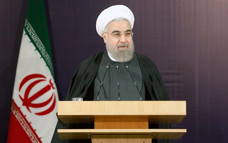 Supporters of Iran's reformist president Hassan Rouhani hope to make gains in parliamentary elections next month (AFP Photo/Atta Kenare)