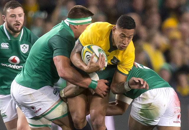 Rugby Union - June Internationals - Australia vs Ireland - Sydney Football Stadium, Sydney, Australia - June 23, 2018 - Israel Folau of Australia is tackled by players of Ireland. AAP/Craig Golding/via REUTERS ATTENTION EDITORS - THIS IMAGE WAS PROVIDED BY A THIRD PARTY. NO RESALES. NO ARCHIVE. AUSTRALIA OUT. NEW ZEALAND OUT.