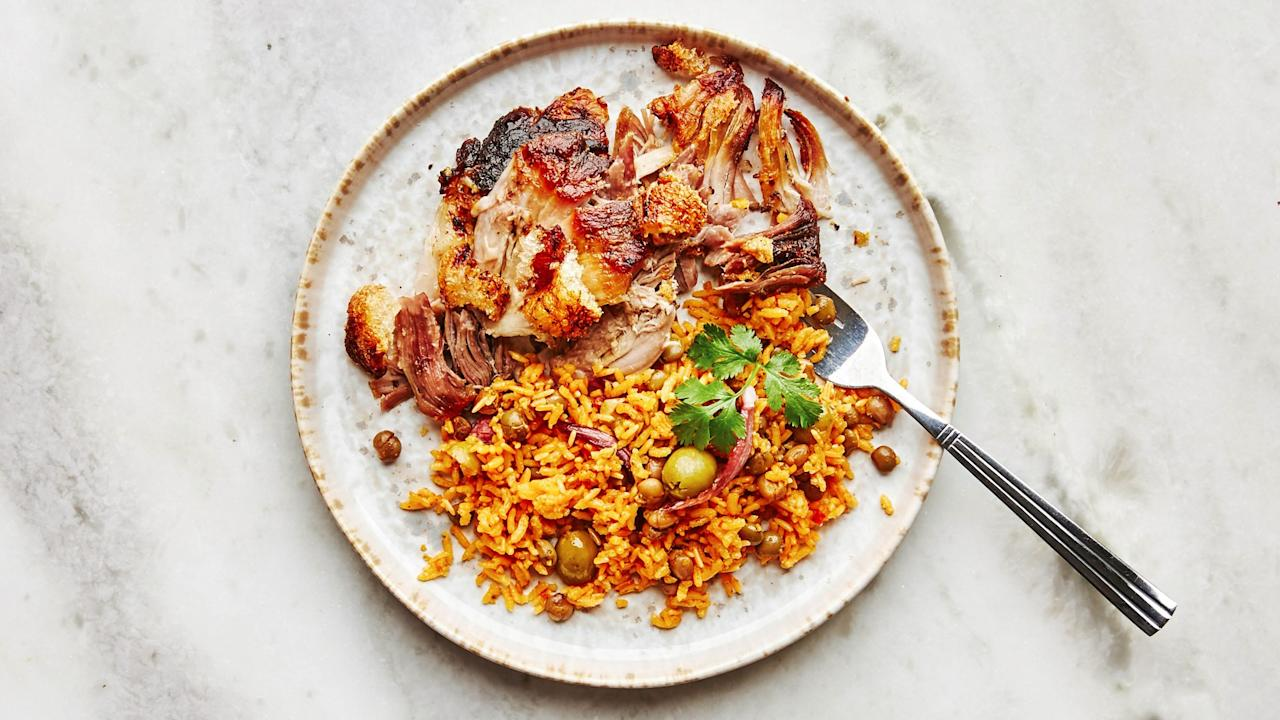 """Nearly every family in Puerto Rico, the Dominican Republic, and Cuba has their own way of roasting pork for the holidays. This Puerto Rican version is almost always served with <a href=""""https://bonappetit.com/recipe/arroz-con-gandules-rice-with-pigeon-peas"""">arroz con gandules (rice with pigeon peas)</a>, and the chicharrón (crispy skin) is heartily fought over. If you can't find <a href=""""https://www.amazon.com/Goya-Sazon-Culantro-Achiote-3-5/dp/B0002HAAOW"""" rel=""""nofollow"""">Sazón</a>, you can use any other seasoning salt, preferably one with a Latin American flavor profile. And if on the off-chance you have any pork left over, use it to make the best sandwiches you've ever tasted. <a href=""""https://www.bonappetit.com/recipe/pernil-slow-roasted-pork?mbid=synd_yahoo_rss"""">See recipe.</a>"""