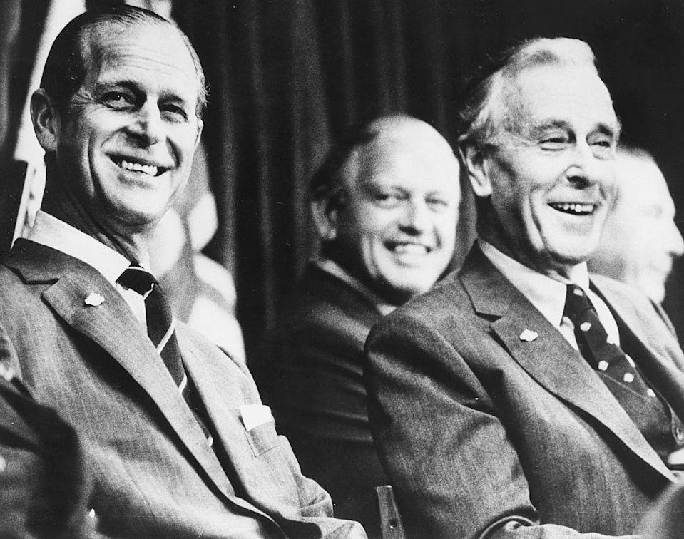 <p>With his uncle Earl Mountbatten, laughing at the opening of the Triennial Conference of the British Commonwealth in New Zealand.</p>