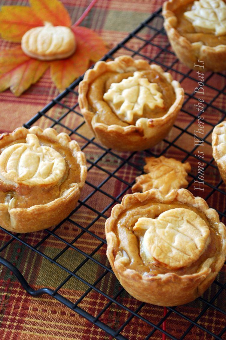 """<p>Fall-themed cookie cutters fashion store-bought piecrust into adorable toppings. </p><p><strong>Get the recipe at <a href=""""http://homeiswheretheboatis.net/2012/11/10/mini-pumpkin-pies-and-a-blooming-can/"""" rel=""""nofollow noopener"""" target=""""_blank"""" data-ylk=""""slk:Home Is Where the Boat Is"""" class=""""link rapid-noclick-resp"""">Home Is Where the Boat Is</a>.</strong></p>"""