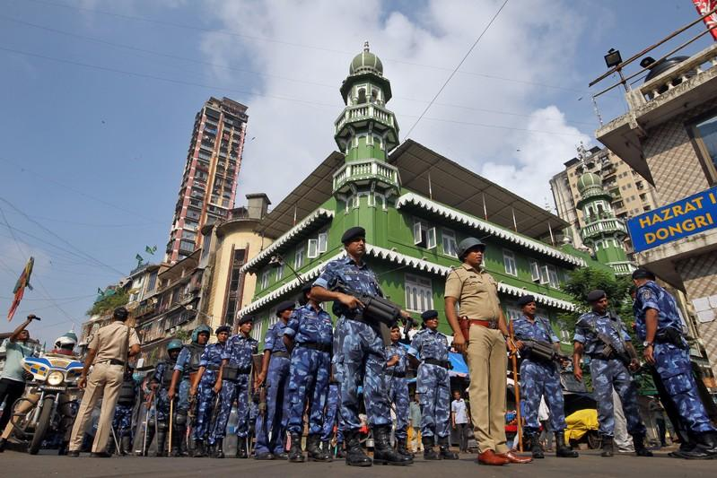 Rapid Action Force personnel stand guard outside a mosque before Supreme Court's verdict on a disputed religious site in Ayodhya, in Mumbai