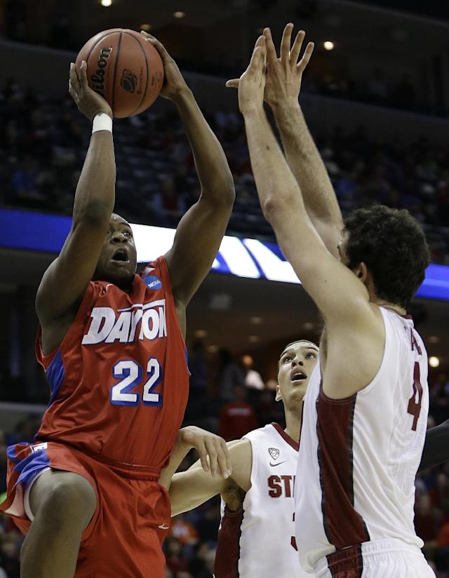 Dayton forward Kendall Pollard (22) shoots against Stanford's Stefan Nastic (4) and Dwight Powell, behind, during the first half in a regional semifinal game at the NCAA college basketball tournament, Thursday, March 27, 2014, in Memphis, Tenn