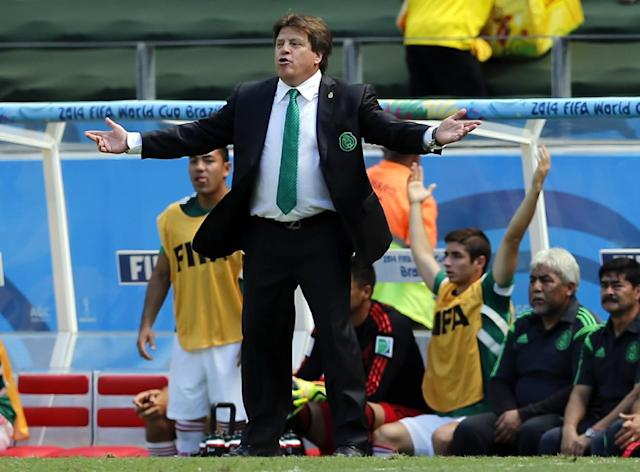 Mexico's head coach Miguel Herrera gestures during the World Cup round of 16 soccer match between the Netherlands and Mexico at the Arena Castelao in Fortaleza, Brazil, Sunday, June 29, 2014. (AP Photo/Wong Maye-E)