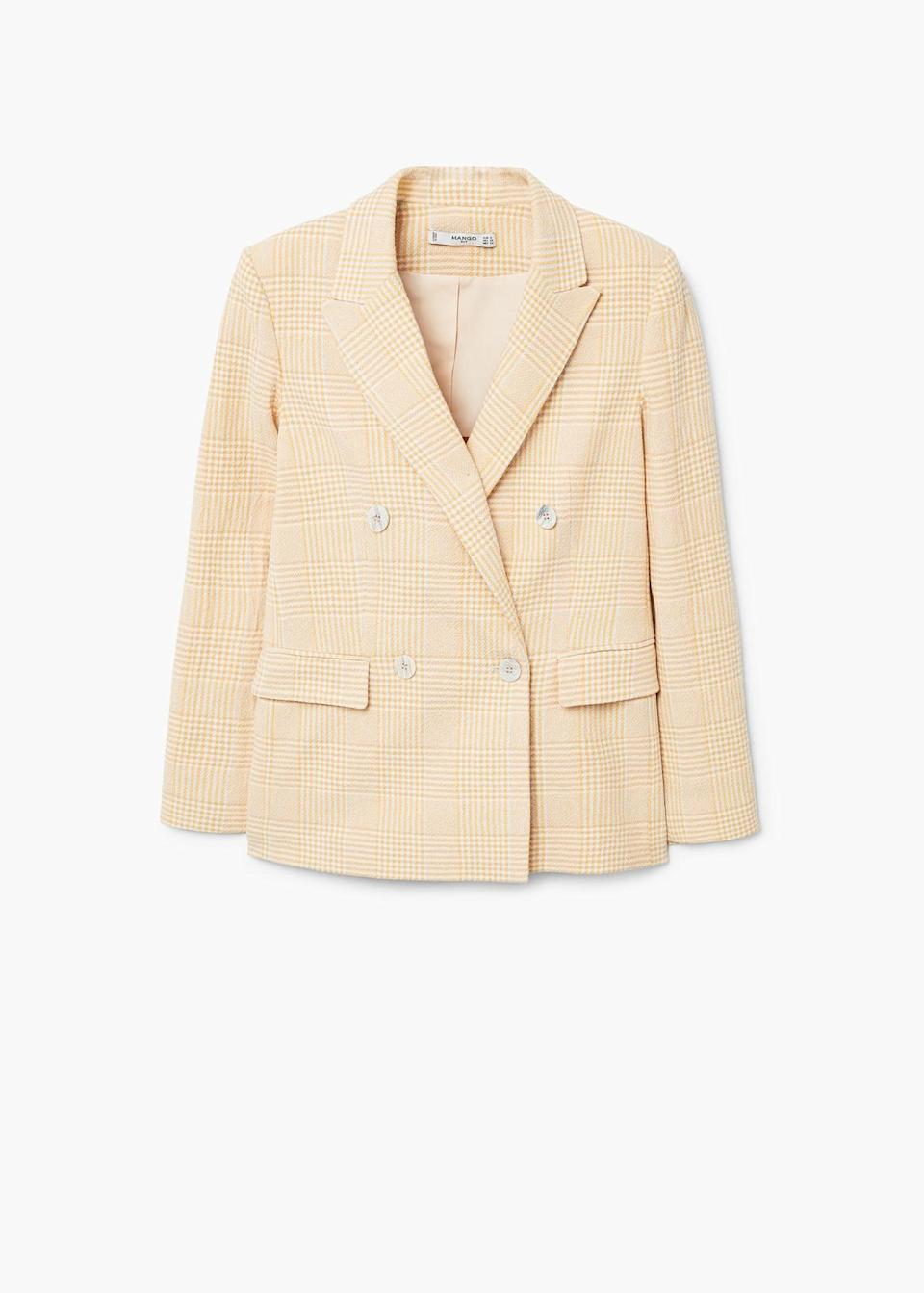 "<p><span>We can't get enough of the blazers over at Mango, and this peach-hued version is the perfect colour for the warmer months. </span><br><em><a href=""https://shop.mango.com/gb/women/jackets-blazers/check-structured-blazer_31010899.html?c=12&n=1&s=nuevo"" rel=""nofollow noopener"" target=""_blank"" data-ylk=""slk:Buy here."" class=""link rapid-noclick-resp""><span>Buy here.</span></a></em> </p>"