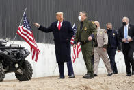 President Donald Trump tours a section of the U.S.-Mexico border wall under construction Tuesday, Jan. 12, 2021, in Alamo, Texas. (AP Photo/Alex Brandon)