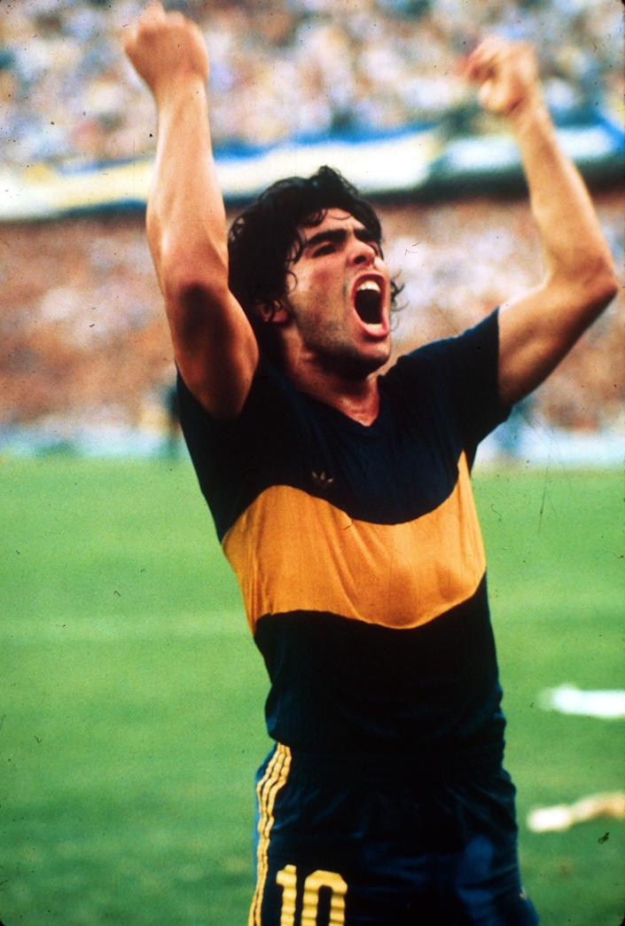 Diego Maradona celebrates a goal while playing with Boca Juniors in 1981.
