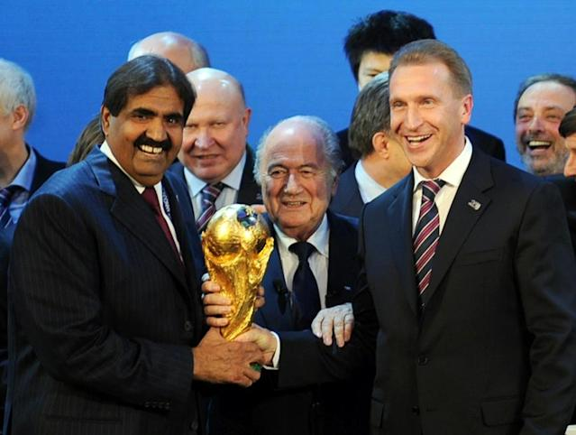 The Emir of the State of Qatar Sheikh Hamad bin Khalifa Al-Thani (L), Fifa President Sepp Blatter (C) and Russia's Deputy Prime Minister Igor Shuvalov posing with the World Cup (AFP Photo/Philippe Desmazes)