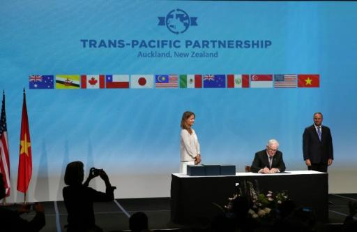 Pacific rim nations sign US-led trade deal amid protests