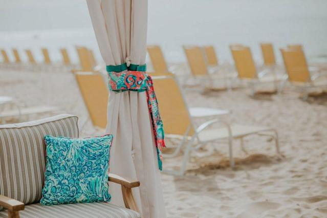 A close-up detail of the Lilly Pulitzer-decorated curtains and printed pillows at the Ocean House cabanas. (Photo: <span>Brooke Brady</span>)