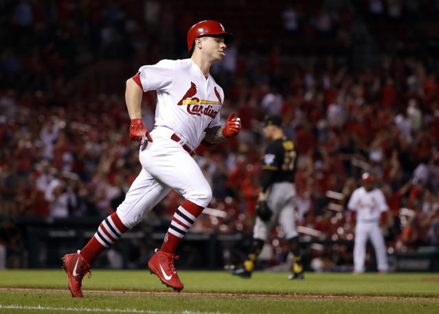 St. Louis Cardinals' Tyler O'Neill, left, rounds the bases after hitting a three-run home run off Pittsburgh Pirates relief pitcher Nick Burdi during the eighth inning of a baseball game, Tuesday, Sept. 11, 2018, in St. Louis. (AP Photo/Jeff Roberson)