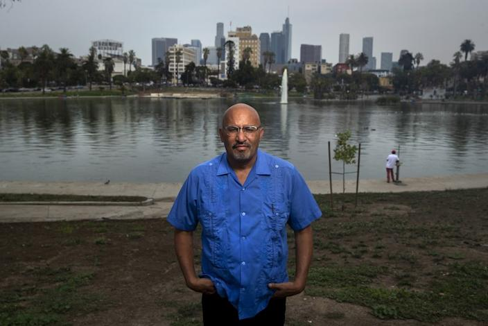 "LOS ANGELES, CA - AUGUST 21: Author Roberto Lovato is photographed at MacArthur Park in Los Angeles. He has a new book coming out about El Salvador titled, ""Unforgetting:A Memoir of Family, Migration, gangs, and Revolution in the Americas."" (Mel Melcon / Los Angeles Times)"