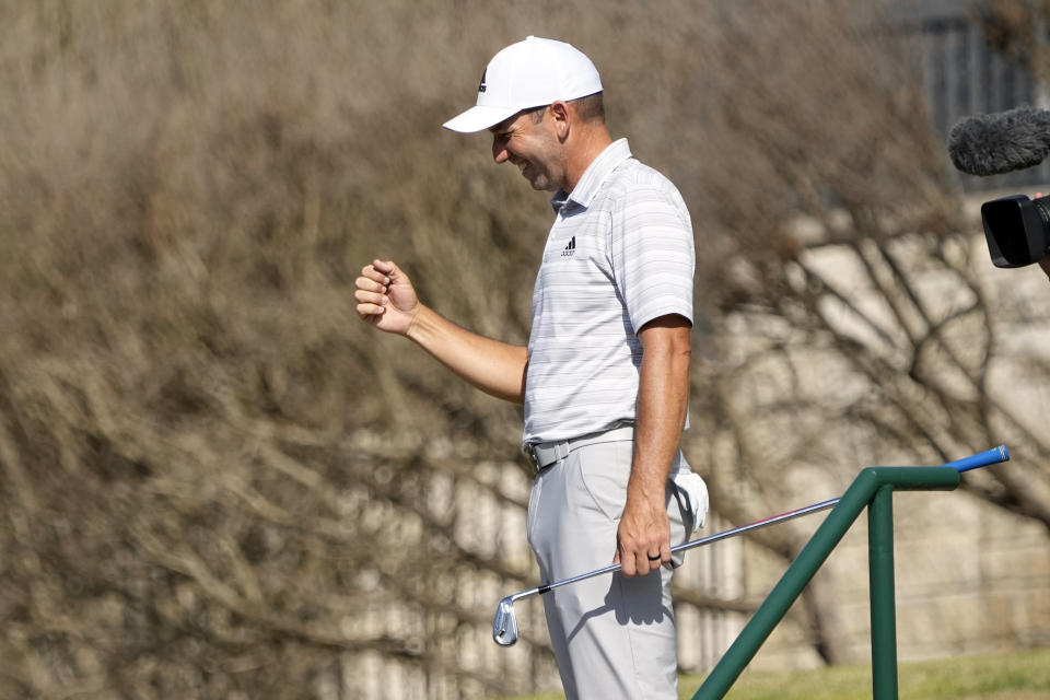 Sergio Garcia, of Spain, celebrates after making a hole in one on the fourth hole to win his playoff against Lee Westwood, of England, during a third round match at the Dell Technologies Match Play Championship golf tournament Friday, March 26, 2021, in Austin, Texas. (AP Photo/David J. Phillip)