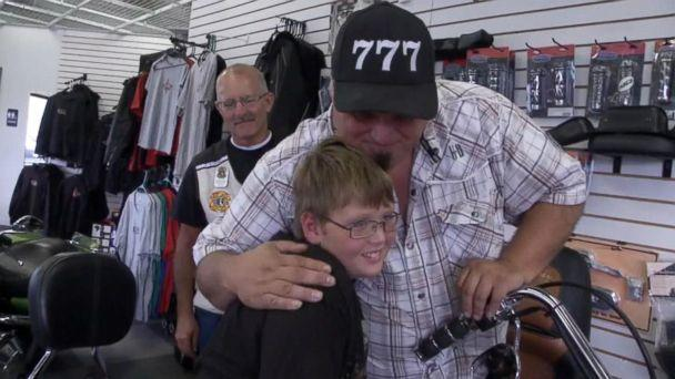PHOTO: Phil Mick, 11, seen with Brett Warfield, sales manager of KDZ Motorcycle Sales & Service, who organized an escort ride for the boy to his first day of middle school on Aug. 1. (Courtesy WPTA)