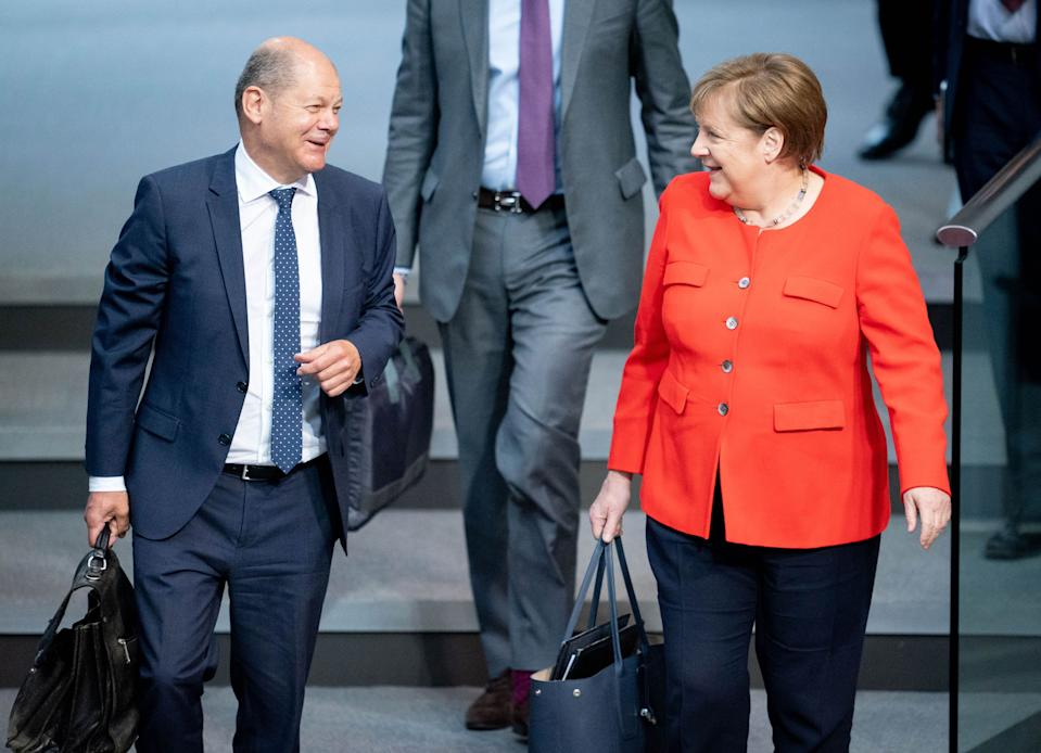 18 June 2020, Berlin: Chancellor Angela Merkel (CDU), and Olaf Scholz (SPD), Federal Minister of Finance, will attend the 166th session of the German Bundestag. Photo: Kay Nietfeld/dpa (Photo by Kay Nietfeld/picture alliance via Getty Images)
