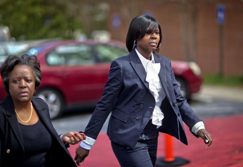 Atlanta Public Schools defendant Sandra Ward, right, turns herself in at the Fulton County Jail accompanied by her attorney Robbin Shipp, left, Tuesday, April 2, 2013, in Atlanta. 35 defendants in Atlanta's school cheating scandal are named in a 65-count indictment that alleges a broad conspiracy involving cheating on standardized tests in Atlanta Public Schools. All 35 defendants must turn themselves in Tuesday. (AP Photo/David Goldman)