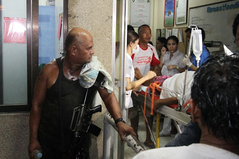 Survivors at a hospital in Cebu, central Philippines late Friday Aug. 16, 2013. Passenger ferry MV Thomas Aquinas with nearly 700 people aboard sank near the central Philippine port of Cebu on Friday night after colliding with a cargo vessel, and a survivor said he saw bodies in the sea. (AP Photo/Chester Baldicantos)
