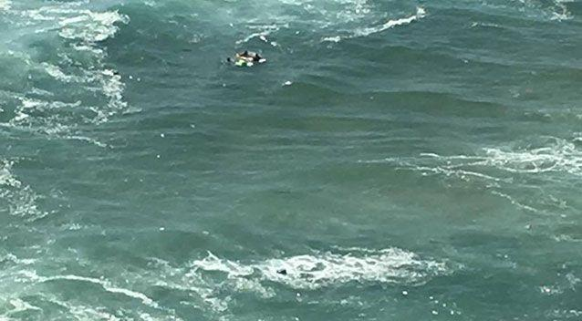Two people have been rescued after their boat capsized. Source: Kristy Lee Brenan