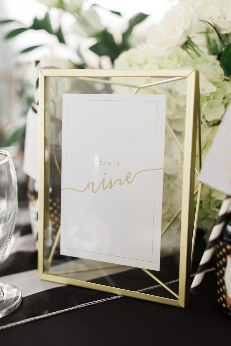 """<p>Get more creative with each table number when you put a handwritten place card in a chic frame. This will elevate each tablescape and give you the freedom to match the frame to your <a class=""""link rapid-noclick-resp"""" href=""""https://www.popsugar.co.uk/tag/Wedding"""" rel=""""nofollow noopener"""" target=""""_blank"""" data-ylk=""""slk:wedding"""">wedding</a> color scheme.</p>"""